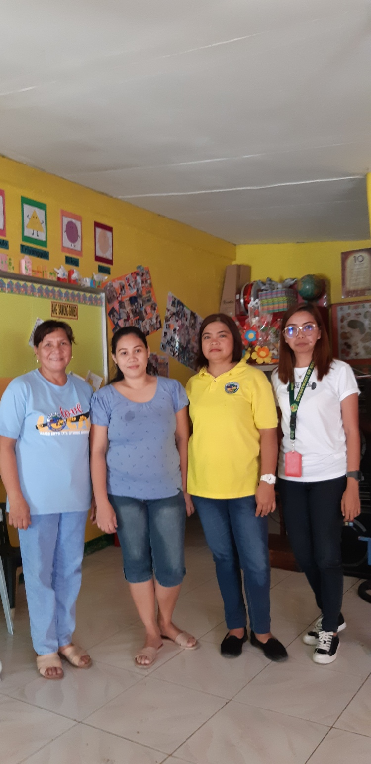 Mary Ann Matilla (2nd from left) and barangay health workers