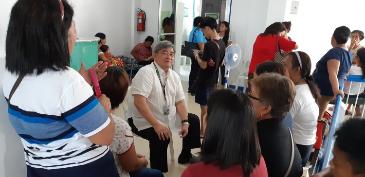 Dr. Juan Antonio Perez talks to women about to undergo bilateral tubal ligation at Ziga Memorial Hospital in Tabaco City, Albay in March 2019